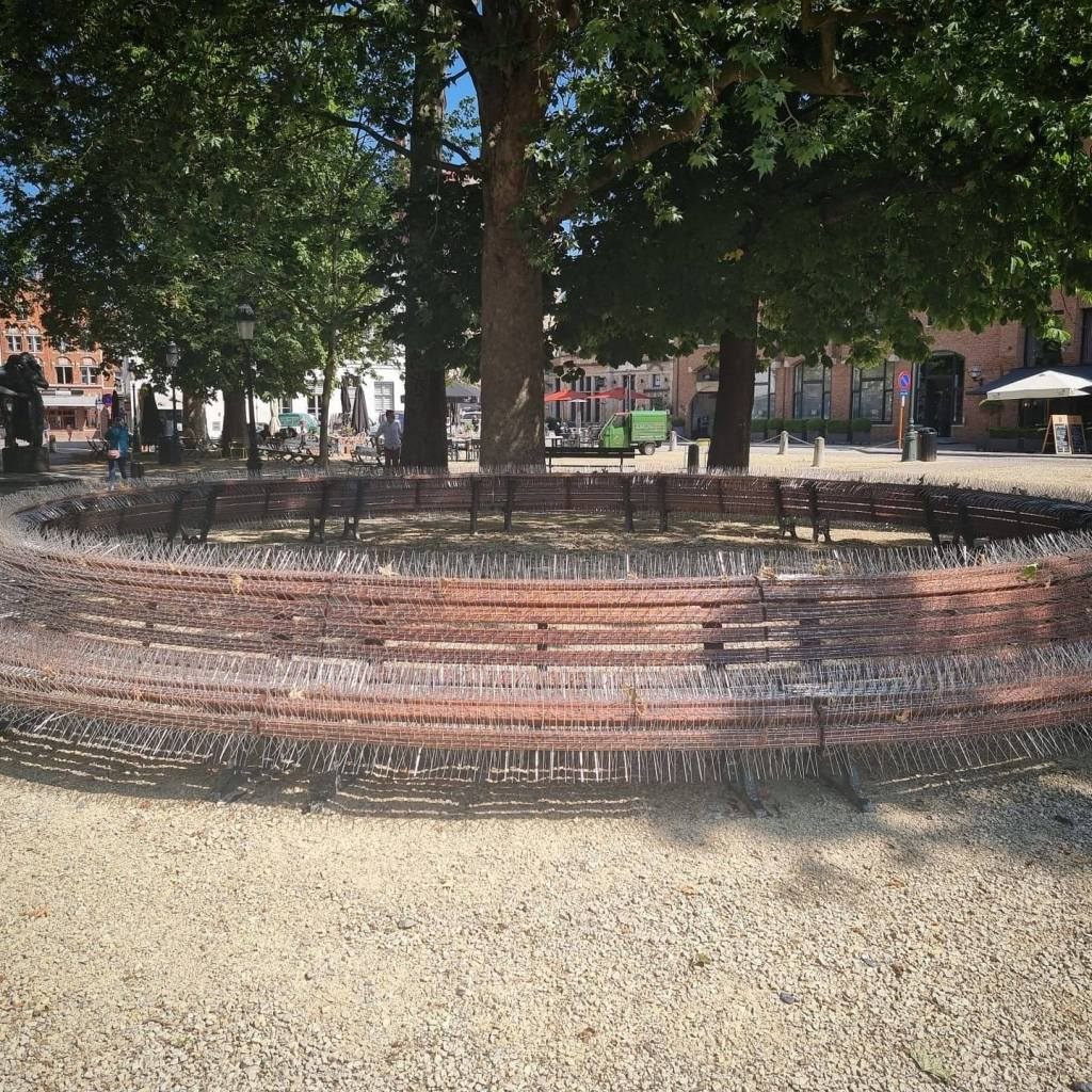 Artwork is a large circular formed bench, covered in upwards spikes.